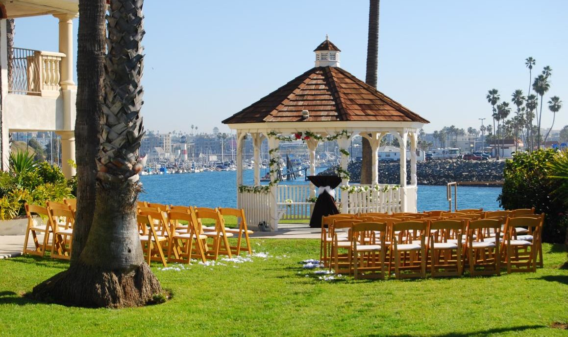 Outdoor Gazebo overlooking the Pacific Ocean with wooden chairs set up for a wedding ceremony